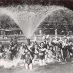 July 15, 1954: With temperatures in the 90s, children escaped the heat under the spray of the fountain in the middle of the Frog Pond.